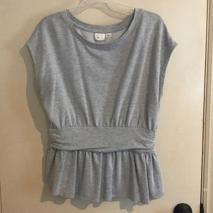 Gray peplum cap-sleeve shirt.